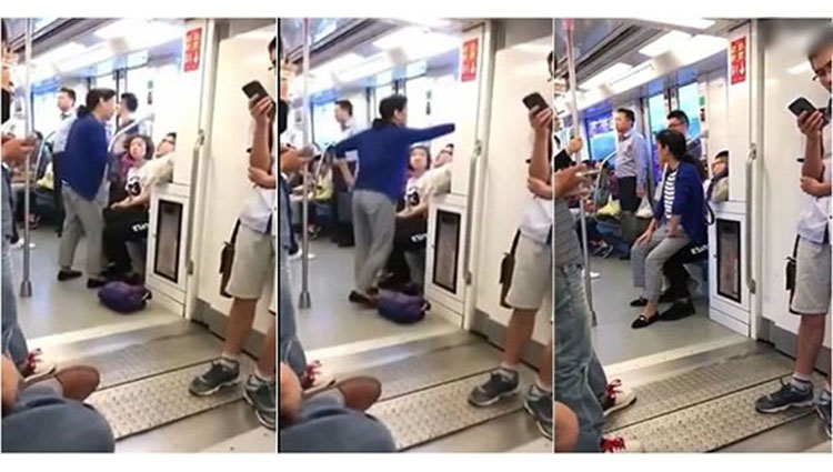 Elderly woman sits on mans lap on the subway after man refuses to give up seat