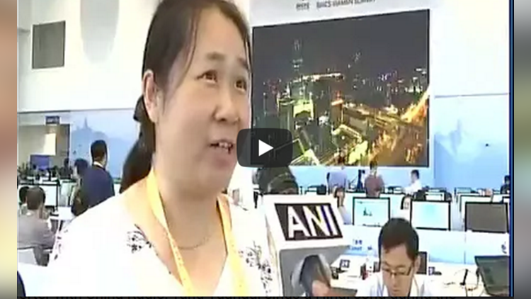 Reporter with China Radio Tang Yuangai sings a Hindi song during the BRICSSummit in Xiamen China