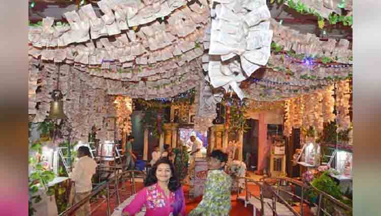 Temple of Goddess Mahalakshmi decorated by money and jewelry in Ratlam