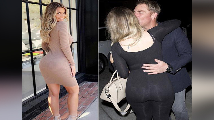 Shane Warne is spotted kissing a Blonde Model emily sears