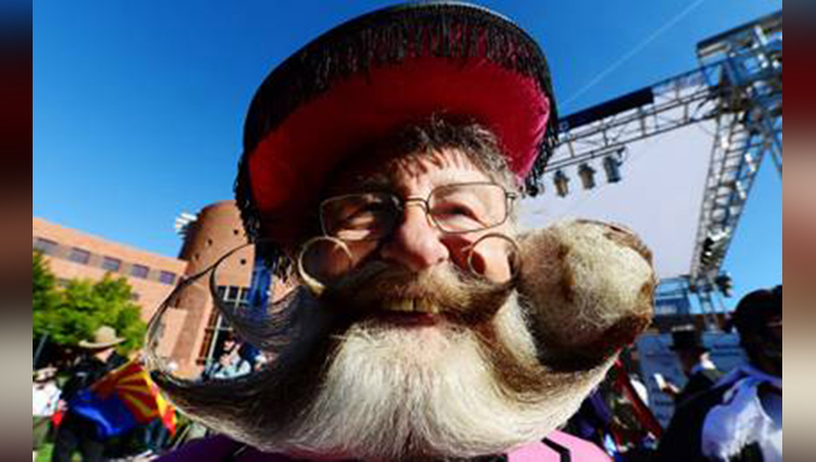 participants click pictures after World Beard and Moustache Championships