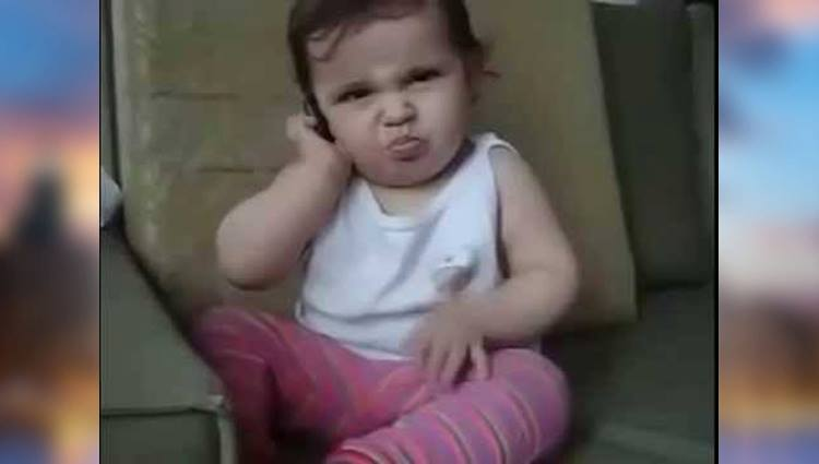 video viral of cute little baby talking on phone